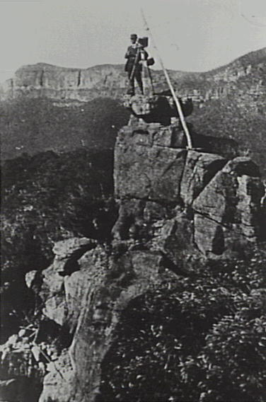 Harry Phillips posing on the top of the Ruined Castle Rocks